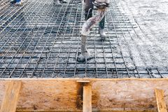 Concrete pouring during concreting floors of buildings in constr. Concrete pouring during commercial concreting floors of buildings in construction - concrete Stock Photography