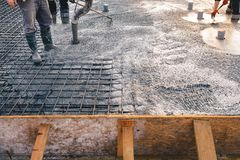 Concrete pouring during concreting floors of buildings in constr. Concrete pouring during commercial concreting floors of buildings in construction - concrete Royalty Free Stock Photos