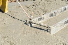 Concrete pouring on the construction site Stock Photos