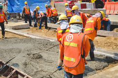 Concrete pouring work during road concreting floors Stock Photo