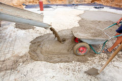 Concrete pouring works stock images