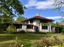 Concrete Prairie Style House. This is a Fall picture of the Edmund F. Brigham House located in Glencoe, Illinois in Cook County. This is the only house designed stock photo