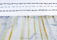 Concrete protection with a barbed wire Royalty Free Stock Photography