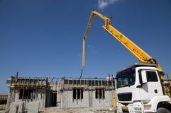 Concrete Pump and a house Stock Photo
