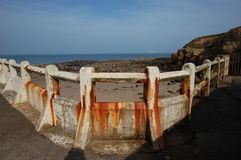 Concrete rail at Tynemouth outdoor pool. The corroded rails at Tynemouth outdoor pool Stock Photo