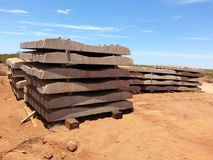 Concrete railway sleepers to construct a train line. Concrete sleepers piled stacked ready for construction of a railway line track Stock Images