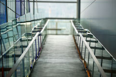 Concrete ramp and rails. Modern style concrete walkway ramp with glass and metal side handrails stock photography