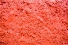 Concrete red convex stone texture of a plastered wall. Background stock image