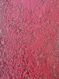 Concrete with red paint. With uneven textured surface Stock Images