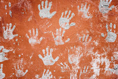 Concrete red wall with prints of hands Royalty Free Stock Images