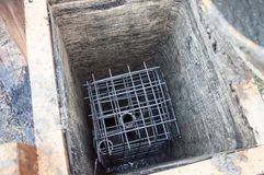 Concrete reinforcement with your own hands. Formwork from the boards. stock photography