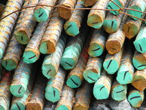 Concrete-reinforcing steel bars colored in green and tied together Stock Photo