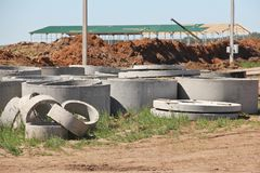 Concrete rings for sewerage construction. royalty free stock photography