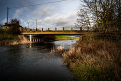 Concrete road bridge over water channel Royalty Free Stock Photography