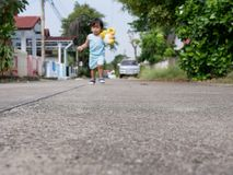 Concrete road in the compound where little Asian baby girl using as a playground and a place to learn how to walk royalty free stock image