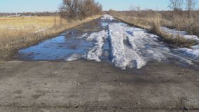 Concrete the road with of melting snow. Concrete the road on which lie the remnants of melting snow stock video