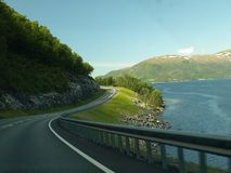 Concrete Road Near Body Of Water Royalty Free Stock Photography