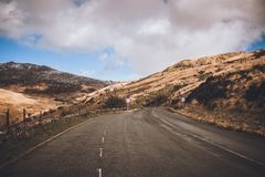 Concrete Road Near Mountains royalty free stock photography