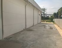 Concrete road near the warehouse. At thailand Stock Image