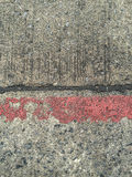 Concrete road with red stripe Royalty Free Stock Images
