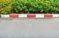 Concrete road with red and white. Curb Stock Photography