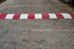 Concrete road with red and white sign. Old concrete road with red and white sign Royalty Free Stock Photo