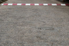 Concrete road with red and white sign. Old concrete road with red and white sign Royalty Free Stock Photography