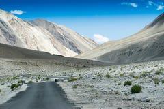 Concrete road towards mountains of Himalaya, Leh, Ladakh Stock Images