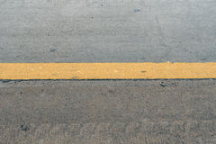 Concrete road with yellow sign line Royalty Free Stock Image