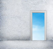 Concrete room with access to blue sky through the doorway Royalty Free Stock Photo