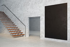 Concrete room with empty chalkboard. Side view of concrete room interior with copy space on empty chalkboard banner stairs and doorway. Success concept. Mock up Stock Image