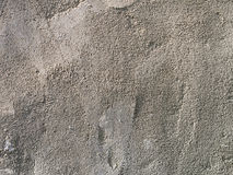 Concrete surface close-up background. Concrete rough surface close-up side light Royalty Free Stock Photo