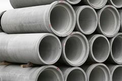 Concrete round pipes stacked. In heap royalty free stock photos