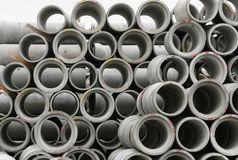 Concrete round pipes stacked. In heap stock photography