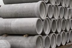 Concrete round pipes stacked. In heap royalty free stock images