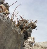Concrete rubble and twisted rusty metal on a demolition site Stock Photos