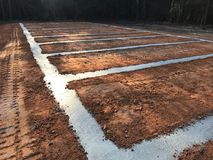 Concrete runners and pad awaiting new home Royalty Free Stock Photography