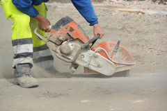 Concrete Saw. Construction worker operated Circular saw with a diamond blade for cutting asphalt and concrete Stock Photography