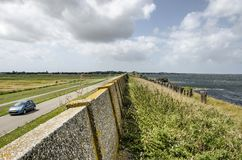 Free Concrete Sea Wall On A Dike Royalty Free Stock Images - 156500699