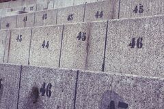 Concrete seats with numbers Stock Photos