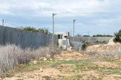 Concrete security separation fence on the border between Israel and Lebanon. royalty free stock photography