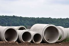 Concrete Sewer Pipes. Different size sewer pipes at a construction site stock images