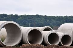 Concrete Sewer Pipes. Different size sewer pipes at a construction site royalty free stock image