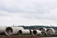 Concrete Sewer Pipes. Different size sewer pipes at a construction site royalty free stock photos