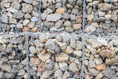 Concrete shapes used as sea wall defense from wave action. Royalty Free Stock Image