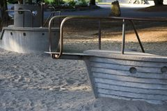 Concrete ships on playground. Concrete ships on sandy playground at park royalty free stock photo