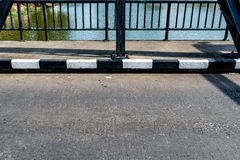 Concrete sidewalk of the bridge Royalty Free Stock Photos