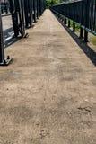Concrete sidewalk of the bridge Royalty Free Stock Images