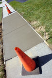 Concrete Sidewalk Fresh Repair and Traffic Cones Stock Image