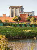 Concrete Silos. Concrete Silo and factory by the river Royalty Free Stock Images
